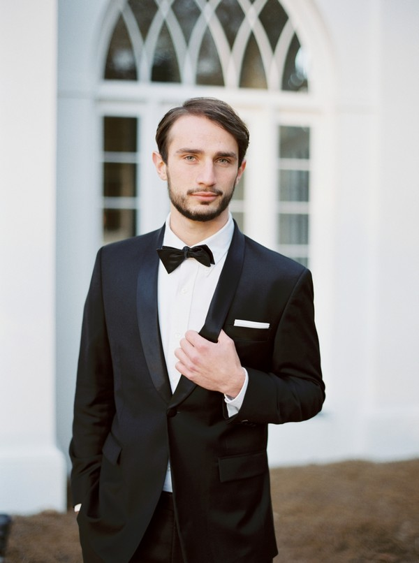 Groom in black tux and bow tie