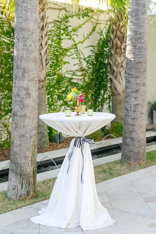 Small vase of flowers on table at wedding