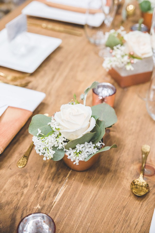 Small pot of white wedding table flowers