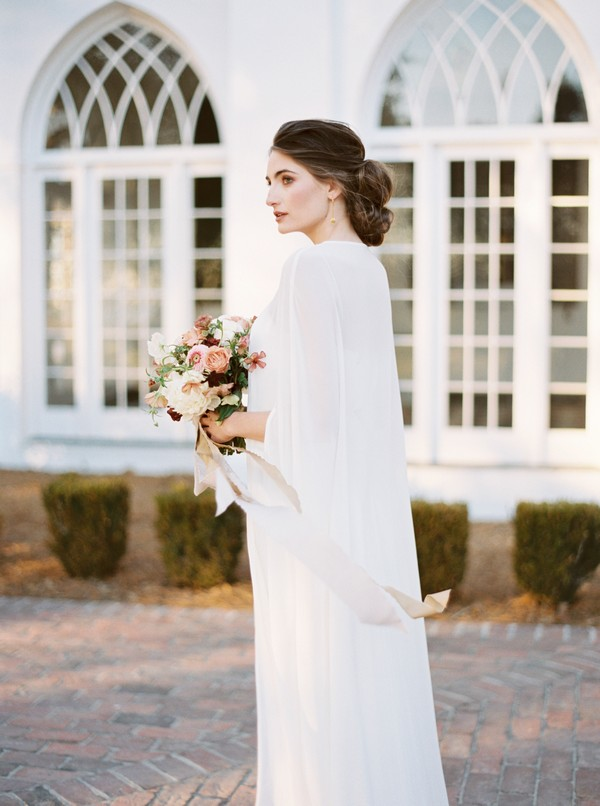 Bride wearing long cape