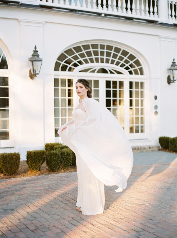 Bride's cape blowing in wind
