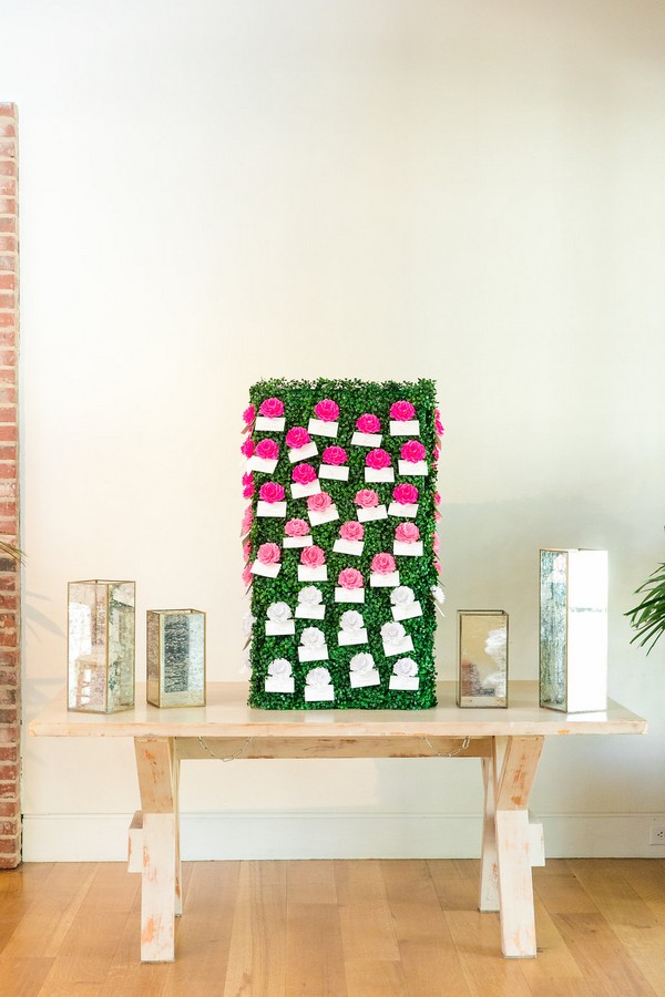 Escort cards attached to flowers on foliage box