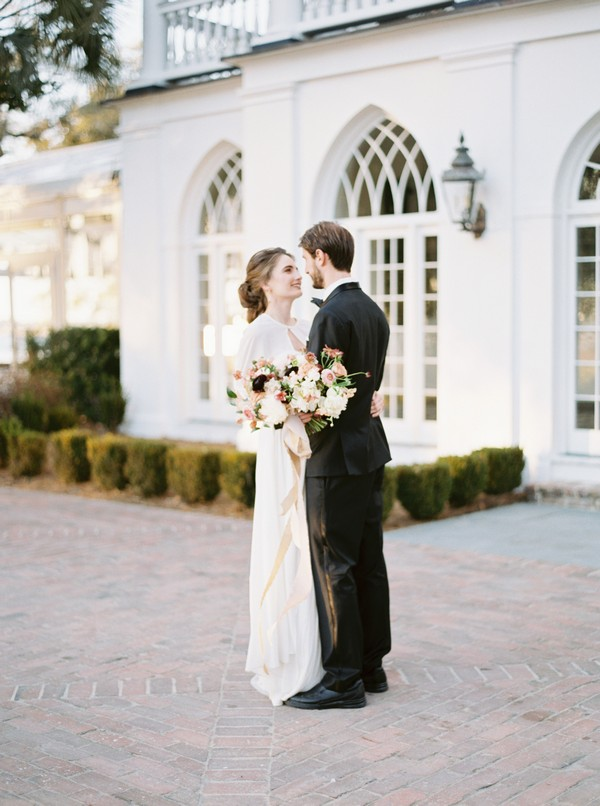 Bride and groom outside Lowndes Grove Plantation
