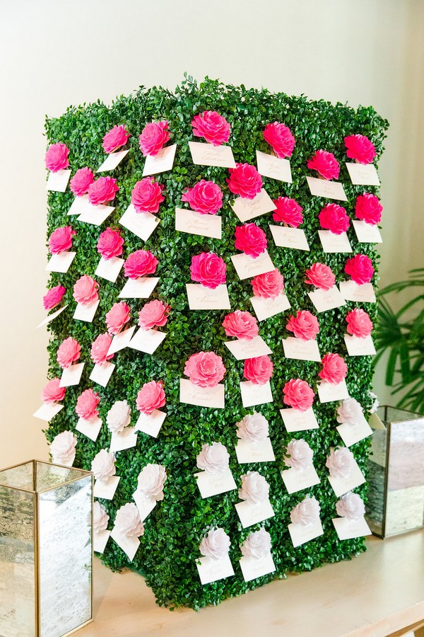 Foliage box with escort cards attached to pink and white flowers