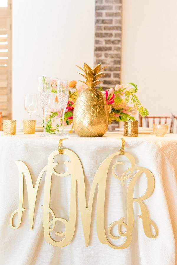 Gold pineapple on wedding table