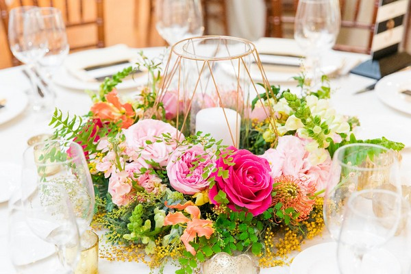 Bright, colourful wedding table flowers