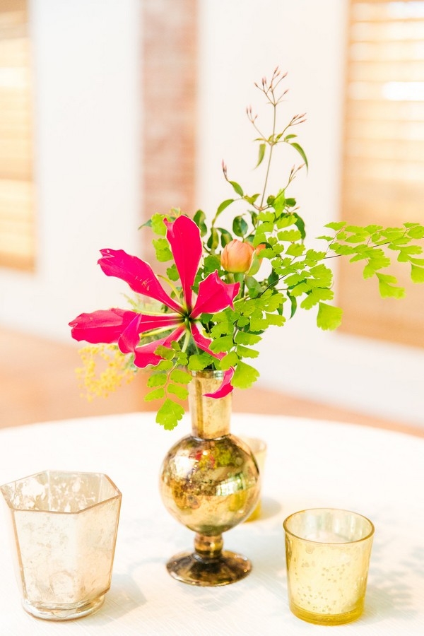 Small gold vase with pink flower and foliage
