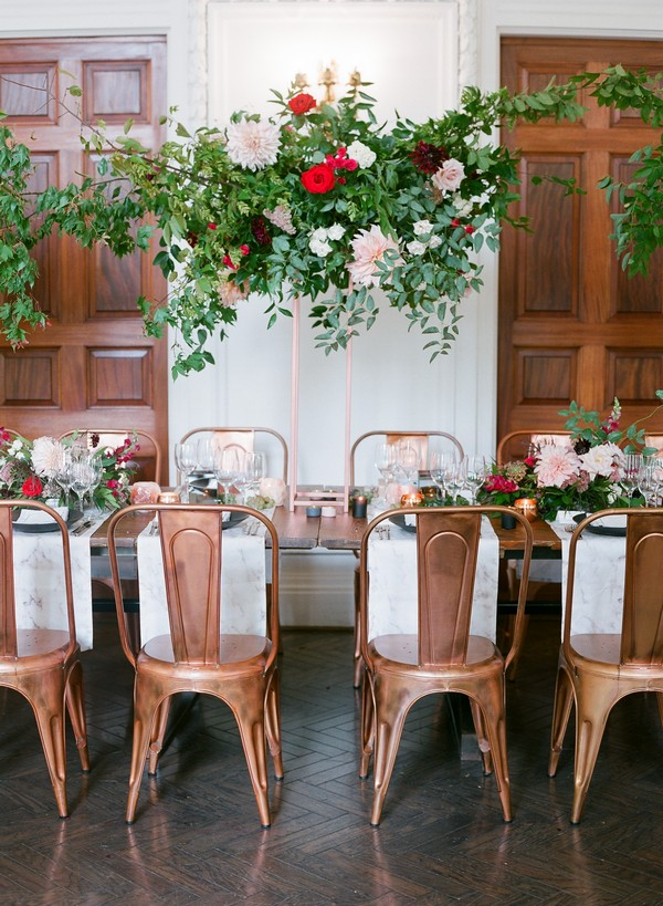 Floral display hanging over wedding table