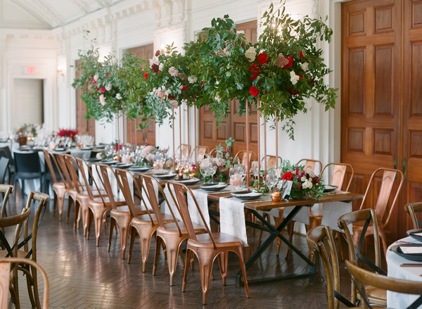 Long wedding table with hanging floral display over top