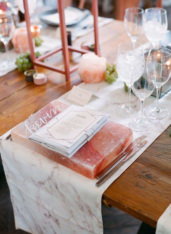 Slab of pink Himalayan salt at wedding place setting