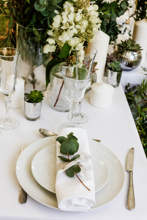 Wedding place setting with eucalyptus leaves