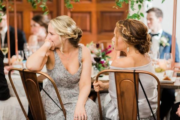 Bridesmaids listening to speech