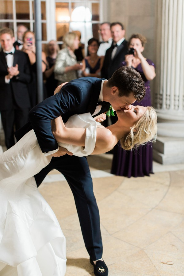 Bride and groom leaning kiss on dance floor
