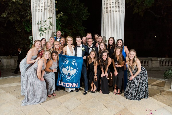 Wedding party with UCONN flag