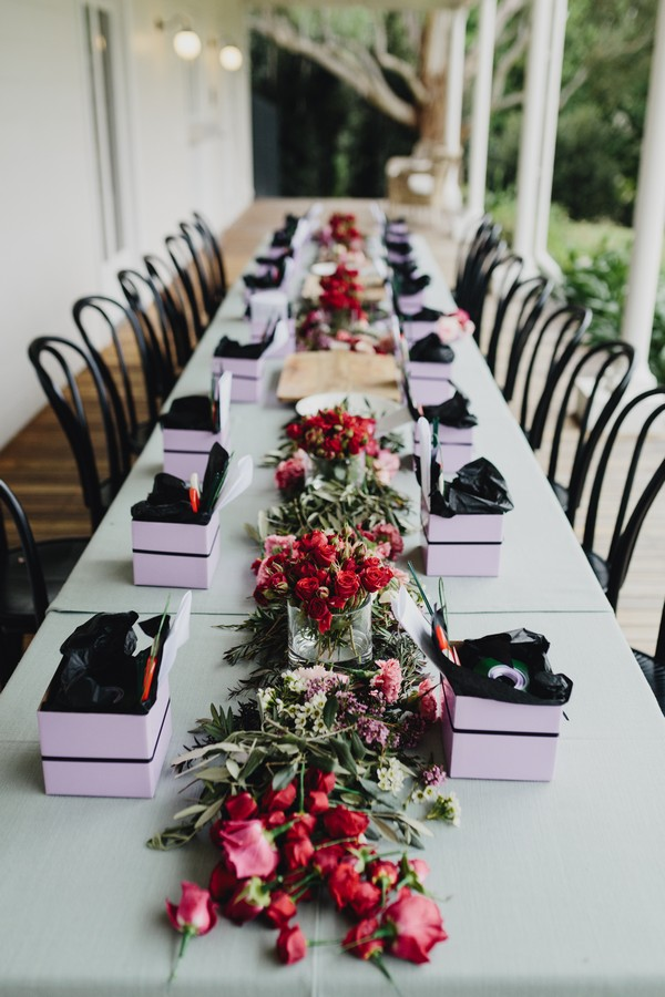 Long table with items needed to make flower crowns