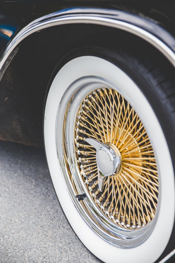 Copper spokes on wheel of Cadillac