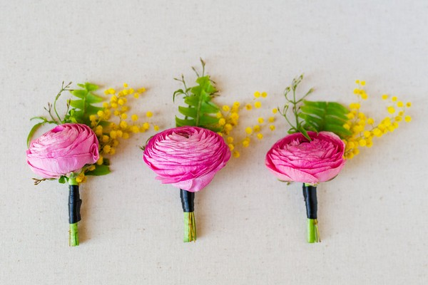 Bright pink flower buttonholes