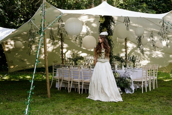 Bride standing by stretch tent at Cosawes Barton