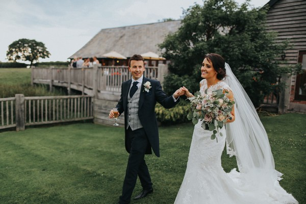 Bride and groom in grounds of Sandhole Oak Barn