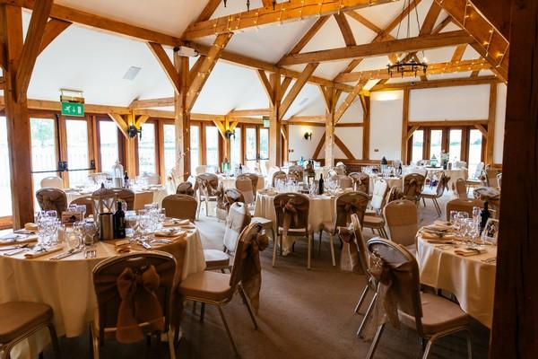 Wedding tables in Dining Barn at Sandhole Oak Barn