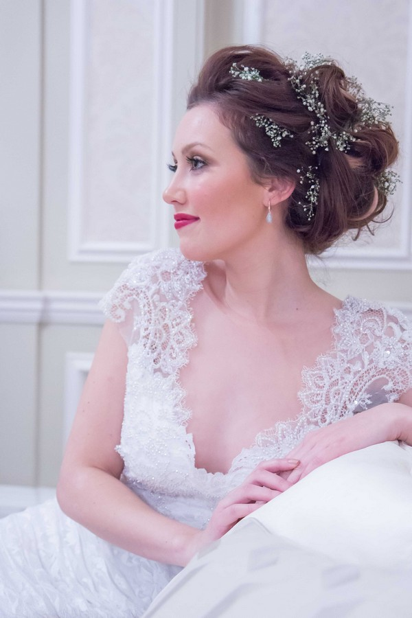 Loose Messy Bun Bridal Hairstyle with Flowers
