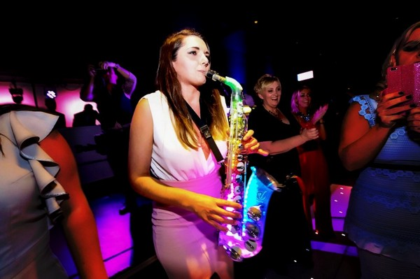 Sax Player performing on dance floor at wedding