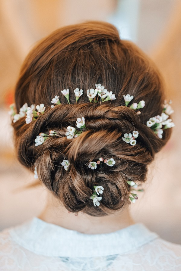 Twisted Bun Bridal Hairstyle with Flowers