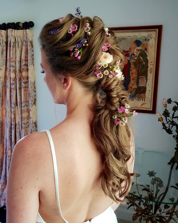 Twisted Loose Ponytail Bridal Hairstyle with Flowers