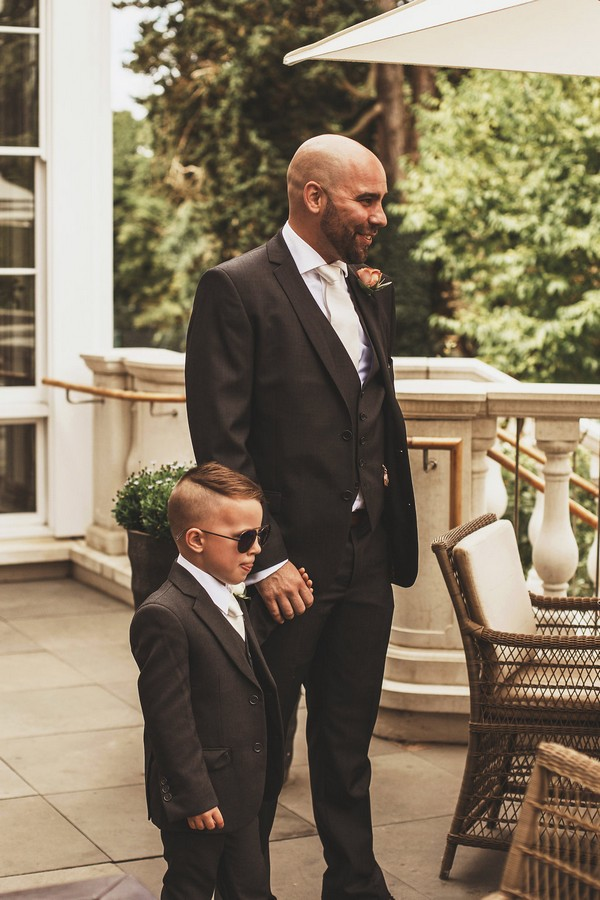 Groom with son before wedding at Coworth Park