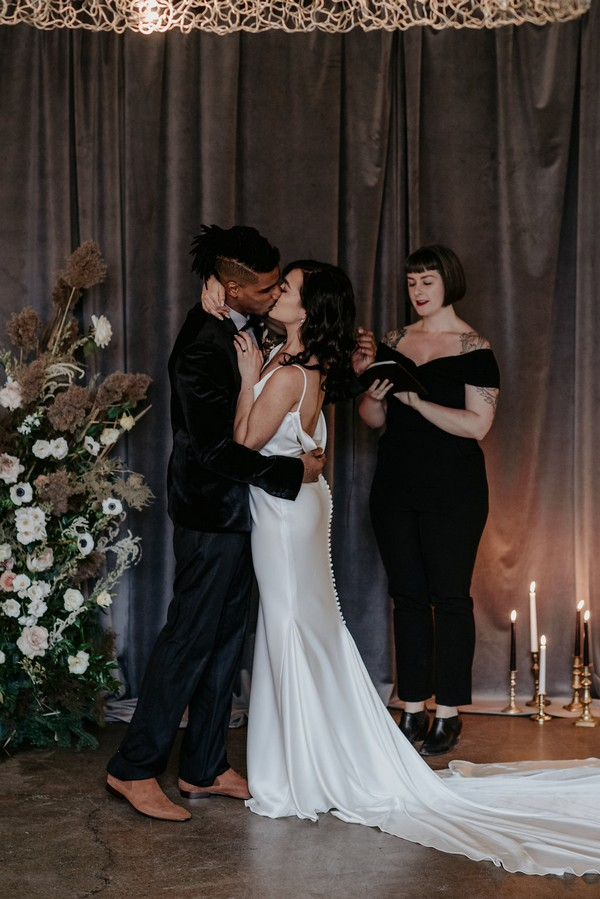 Couple kissing after being pronounced husband and wife