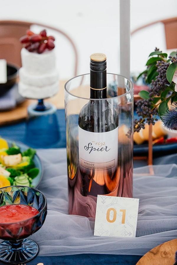 Bottle of wine in copper cooler