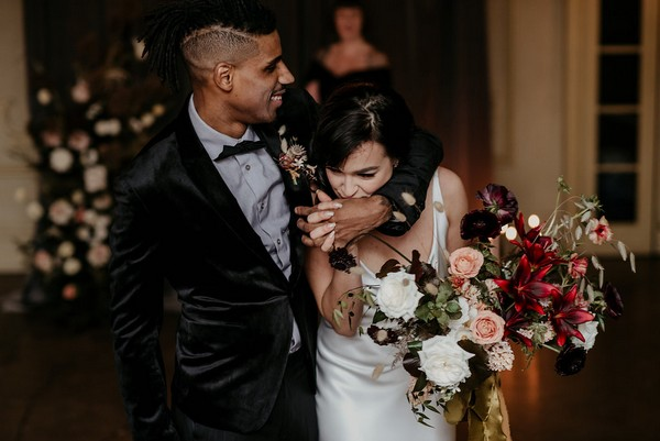 Bride kissing groom's hand as they leave elopement ceremony