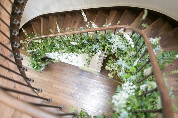 Staircase at Chateau de Redon decorated with foliage