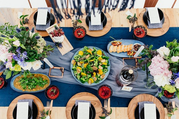 Aerial view of food on wedding table with blue and copper details