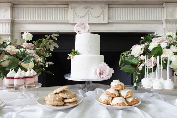White wedding cake, cookies and profiteroles