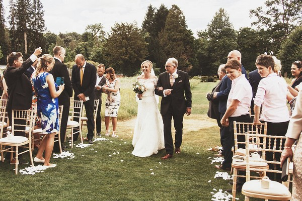 Father walking bride down the aisle for outdoor wedding at Coworth Park