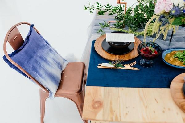 Blue cushion on copper wedding chair