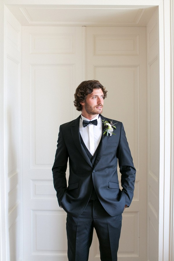 Groom with hands in pockets