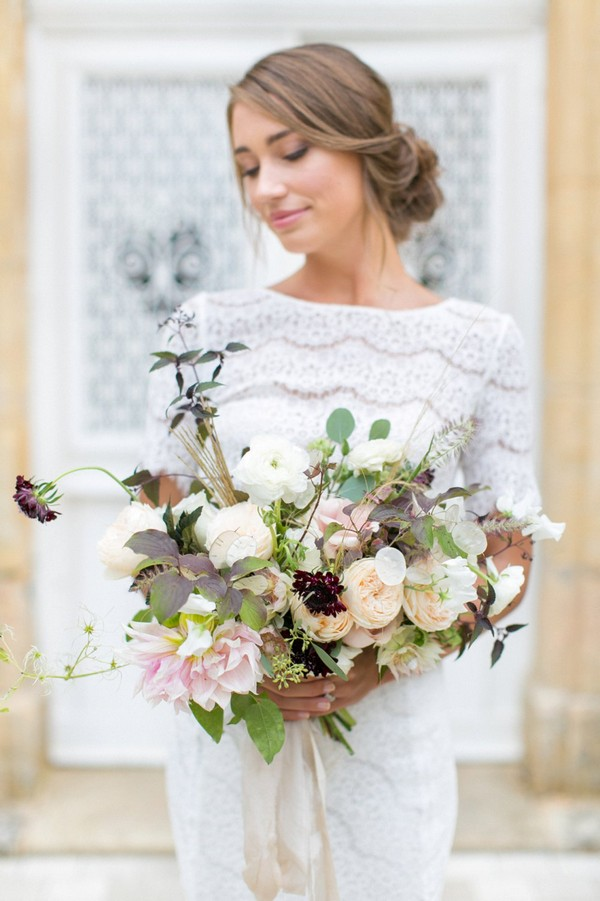 Bride holding natural, organic wedding bouquet