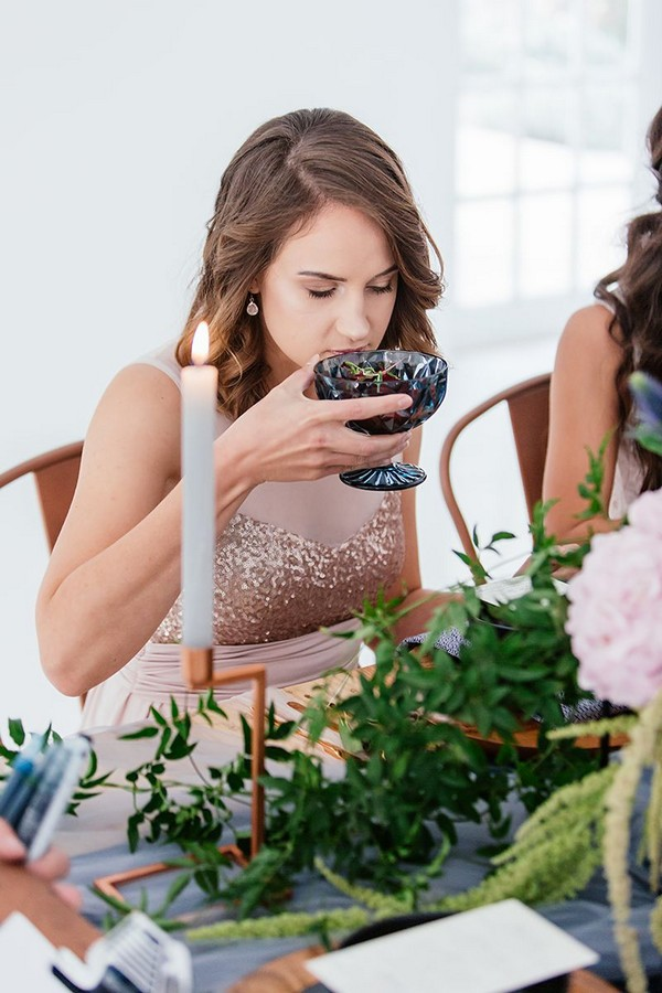 Wedding guest lifting starter up to her nose