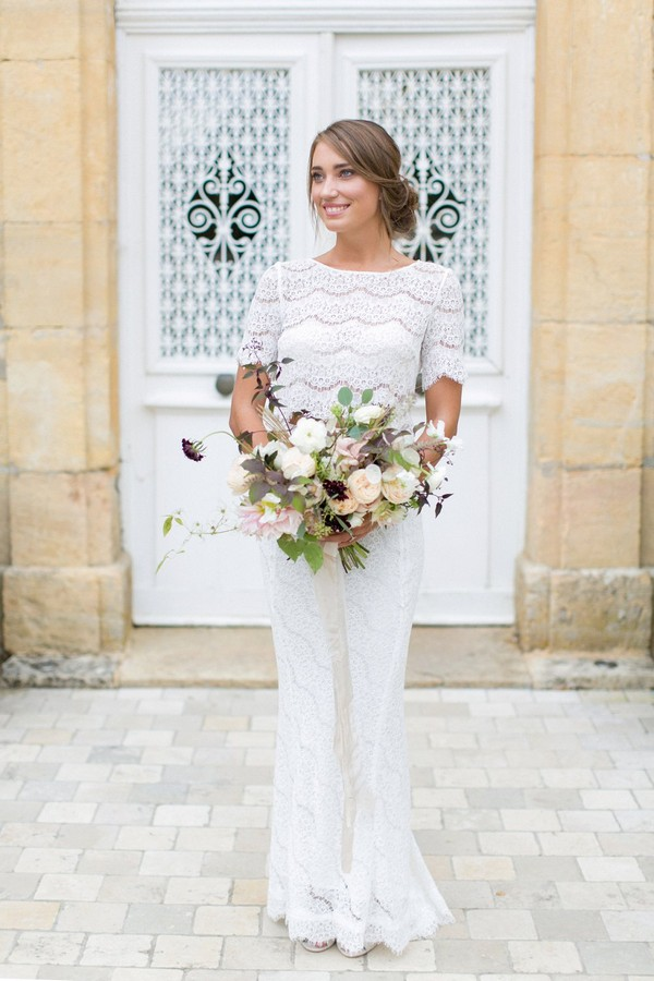 Bride in two piece wedding dress holding bouquet