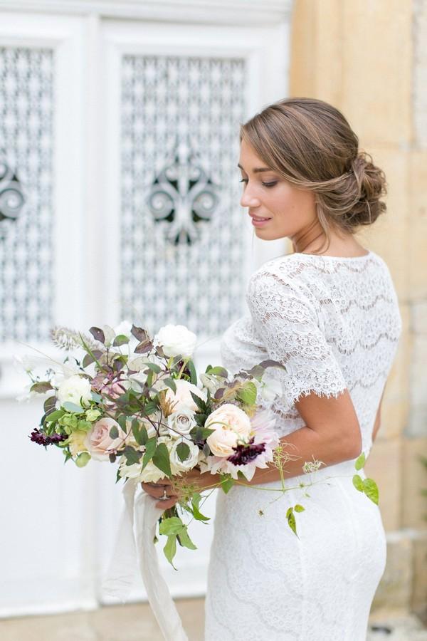 Bride holding natural bridal bouquet