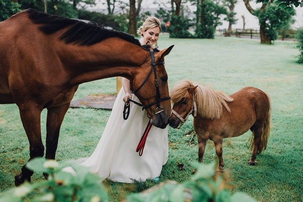 Bride with horse and foal - Picture by Butterfly Photography
