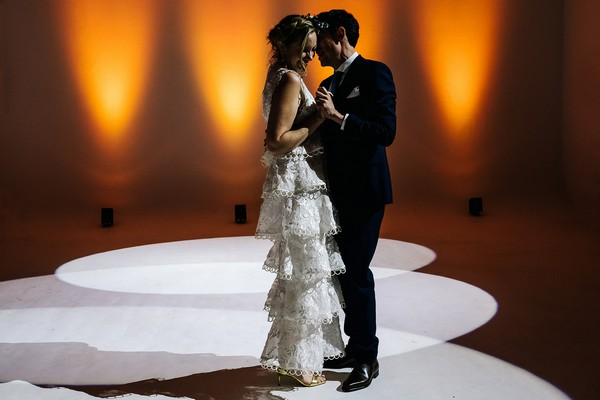Bride and groom dancing in spotlight at wedding - Picture by Kristian Leven Photography