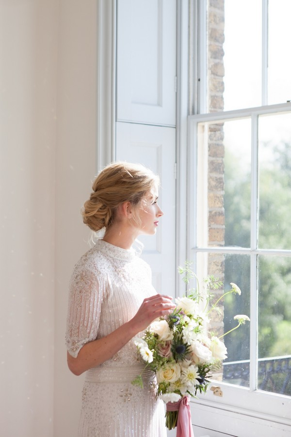 Bride looking out of window at Clissold House