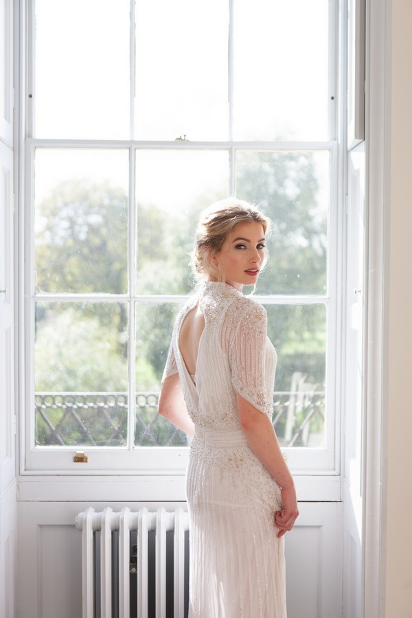 Bride standing by window at Clissold House