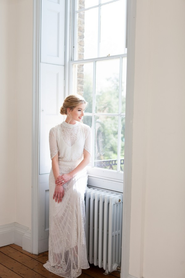 Bride sitting by window at Clissold House
