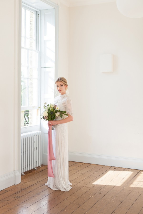 Bride standing holding bouquet