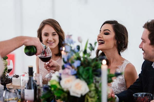 Bride being poured wine