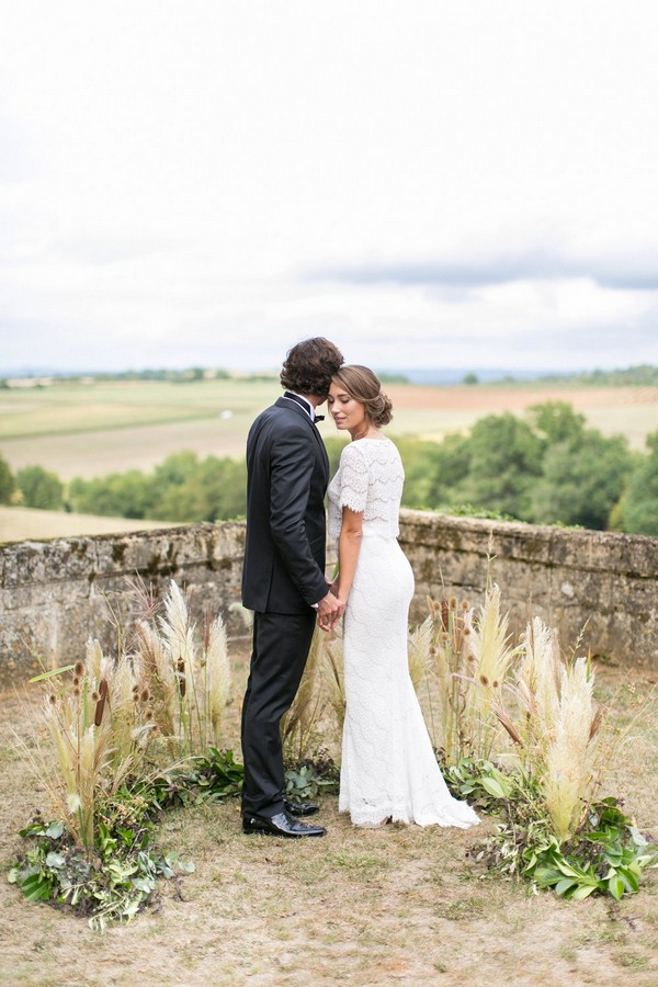 Bride and groom standing with views of Dordogne